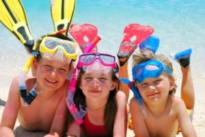 Three kids in snorkel gear.
