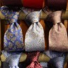 Neckties Tied to a Wooden Dowel