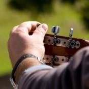 Man Tuning His Guitar