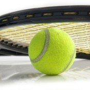 Tenis Racket Resting on Tennis Ball