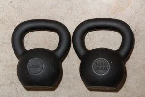 Using Kettlebells, Saving Money on Kettlebells2 Kettlebells Laying on Concrete