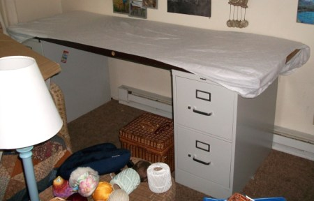 An old door on a file cabinet to use as a desk.