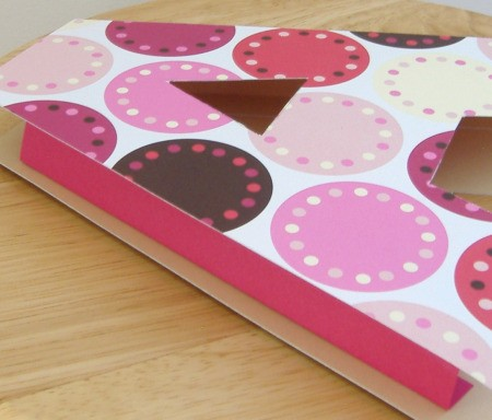 Patterned cut out of the letter A on top of the smaller pink cutout