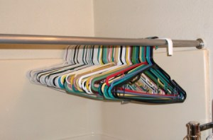 Hang extra hangers on a closet rod in the shower.