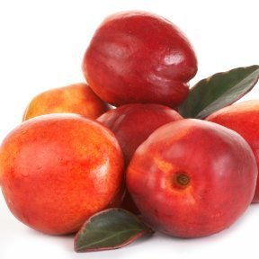Small stack of nectarines against white background.