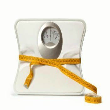 Inexpensive Ways to Lose Weight, Scale being cinched in by a tape measure.
