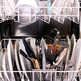 Interior of a full dishwasher.