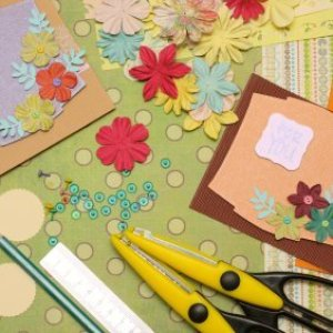 Scrapbooking papers, embellishments, and scissors.