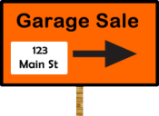 Orange garage sale sign with large black arrow and address in lower left corner.