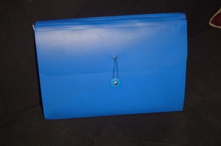 A blue expandable file box for important paperwork.