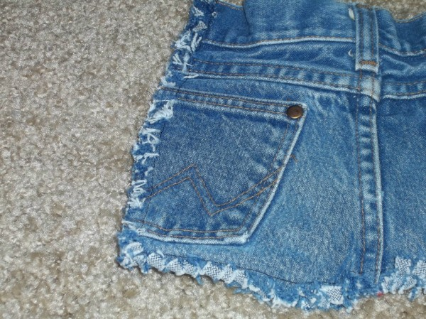 Cut off pair of blue jeans viewed from the back.