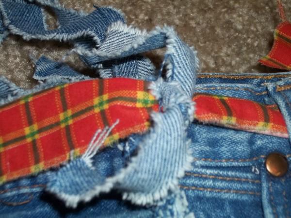 Adding Halloween fabric belt to Jean bag.