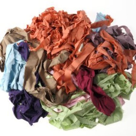 Loose ball of cut up t-shirts for crafting.