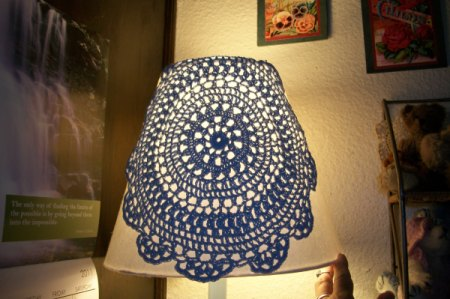 Doily pinned to outside of lampshad