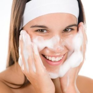 Preventing Acne, Young Woman washing her face