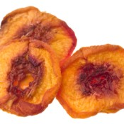 Three dried peach slices.