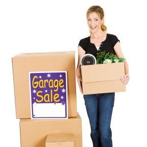 Woman holding a box for a garage sale
