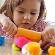 Girl Playing with Colorful Playdough