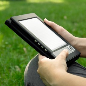 Buying an eBook Reader, Someone using an eBook reader.