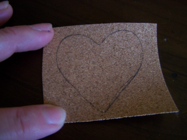 square piece of cork with heart traced on it