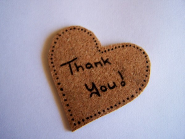 cork cut into the shape of a heart with the wrods Thank you! <div class=