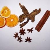Dried oranges, cinnamon sticks, star anise, dried cinnamon flowers