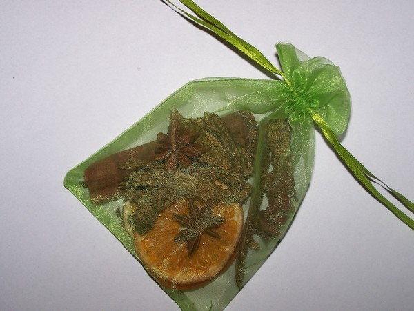 Green mesh bag filled with dried potpourri