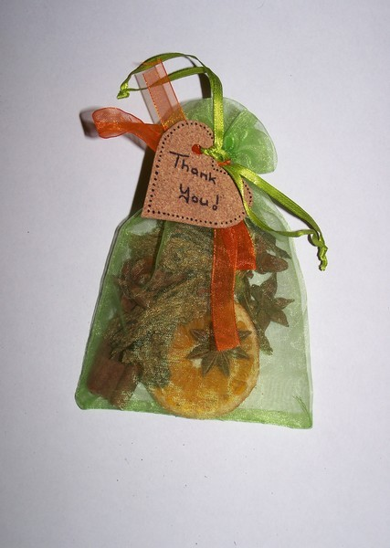 potpourri bag with orange ribbon attached