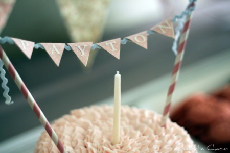 Bunting trung across the top of a small pink cake