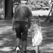 Girl Holding Hand and Walking with Great-Great Grand Father