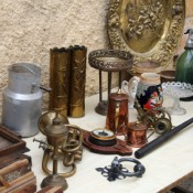 A table filled with antique nicknacks.