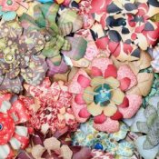 Paper flowers made with multicolored and patterned papers.