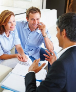 Selecting a Broker or Financial Planner, Happy Couple Talking With Financial Consultant
