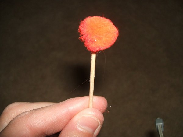Red Pompom on end of toothpick