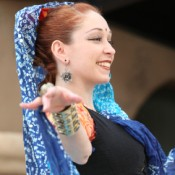 Smiling Woman in Belly Dance Costume
