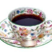 China tea cup and saucer with floral pattern.