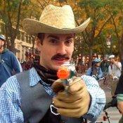 Man POinting Toy Gun in Cowboy Costume