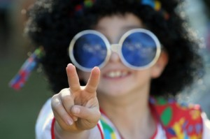 Boy Holding up Peace Sign in Hippie Costume