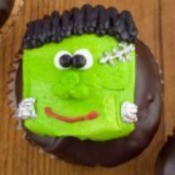 Cupcake with a Frankenstein decoration on top.