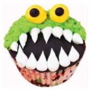 Monster cupcake with it's mouth open wide.