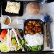 Eating Healthy While You Travel, A tray of prepackaged airline food.