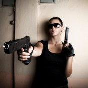 Woman Dressed as Lara Croft Pointing Gun