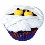 Mummy cupcake with yellow eyes.