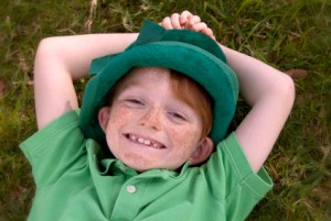Little Boy Laying in the Grass Dressed as a Leprechaun