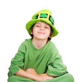 Boy Sitting Cross Legged in Leprechaun Costume