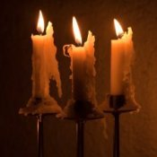 Candlesticks with melting candles on them.