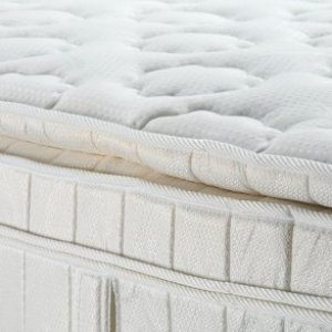 Up close photo of a pillow top mattress.