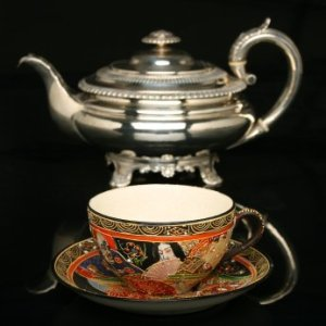 Cleaning Silver, Silver tea pot with an antique Chinese tea cup and saucer.
