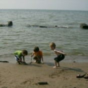 Three Young Boys Playing on Beach