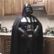 Man Standing in Kitchen in Darth Vader Costume